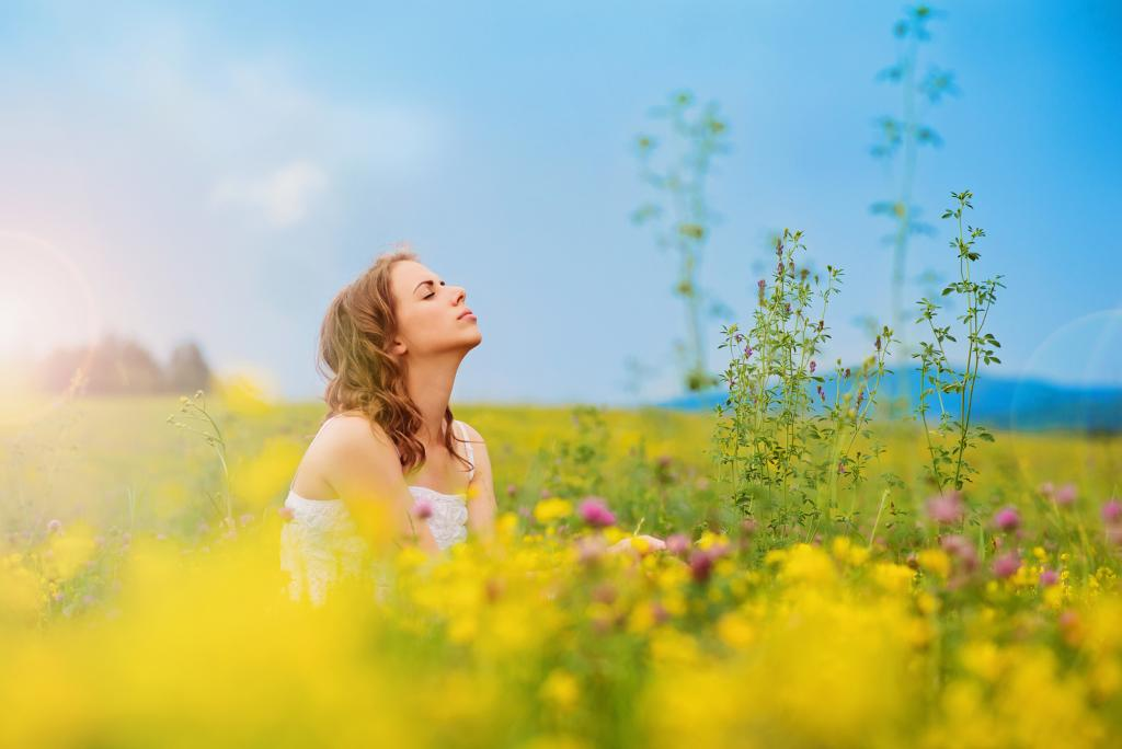Beautiful woman on a meadow.